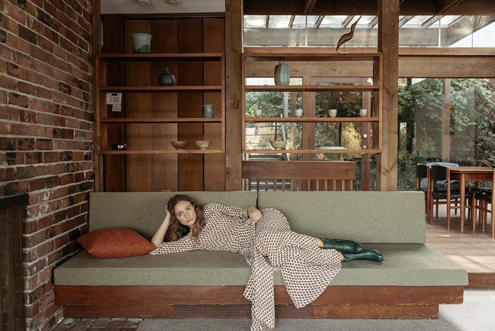 Female Model laying down in a modern house